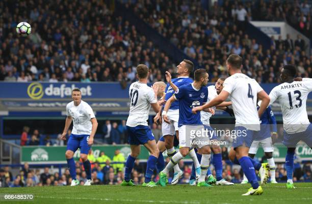 Phil Jagielka of Everton scores his team's third goal during the Premier League match between Everton and Leicester City at Goodison Park on April 9,...