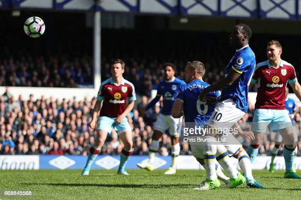 Phil Jagielka of Everton scores the first goal to make the score 1-0 during the Premier League match between Everton and Burnley at Goodison Park on...