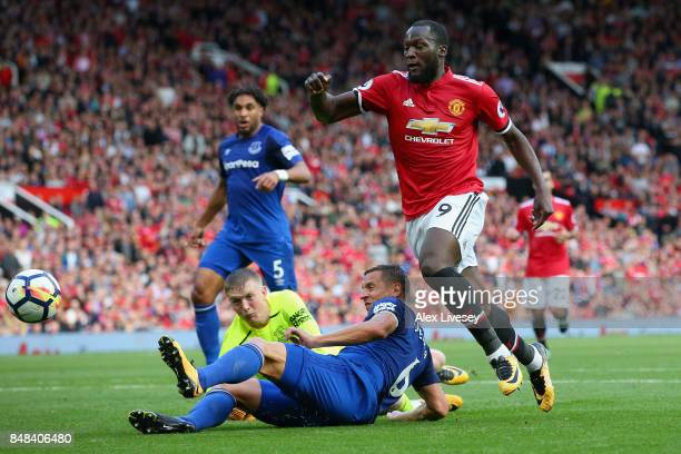 Phil Jagielka of Everton tackles Romelu Lukaku of Manchester United during the Premier League match between Manchester United and Everton at Old...