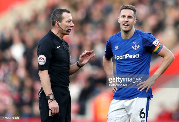 Phil Jagielka of Everton talks to referee Kevin Friend during the Premier League match between Southampton and Everton at St Mary's Stadium on...