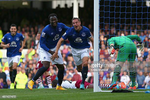 Phil Jagielka of Everton turns to celebrate after scoring the opening goal during the Barclays Premier League match between Everton and Aston Villa...