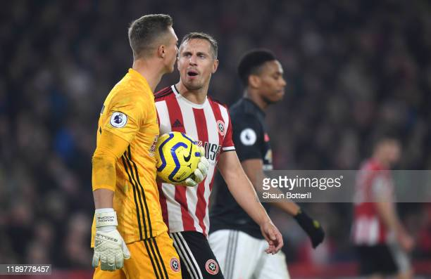 Phil Jagielka of Sheffield United congratulates teammates Simon Moore during the Premier League match between Sheffield United and Manchester United...