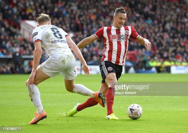 Phil Jagielka of Sheffield United is put under pressure Ryan Croasdale of AFC Fylde during the FA Cup Third Round match between Sheffield United and...