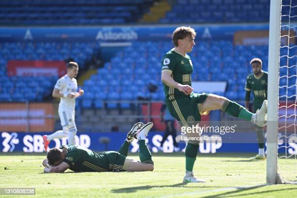 Phil Jagielka of Sheffield United reacts after scoring an own goal for Leeds United's second goal as Ben Osborn kicks the post in frustration during...