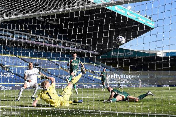 Phil Jagielka of Sheffield United scores an own goal past Aaron Ramsdale for Leeds United's Second goal during the Premier League match between Leeds...