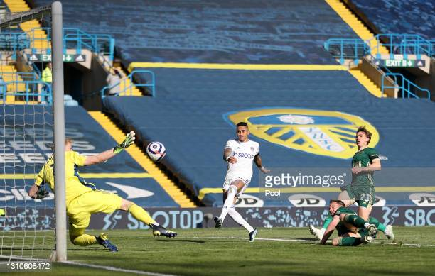 Phil Jagielka of Sheffield United scores an own goal under pressure from Raphinha of Leeds United for Leeds United's second goal during the Premier...