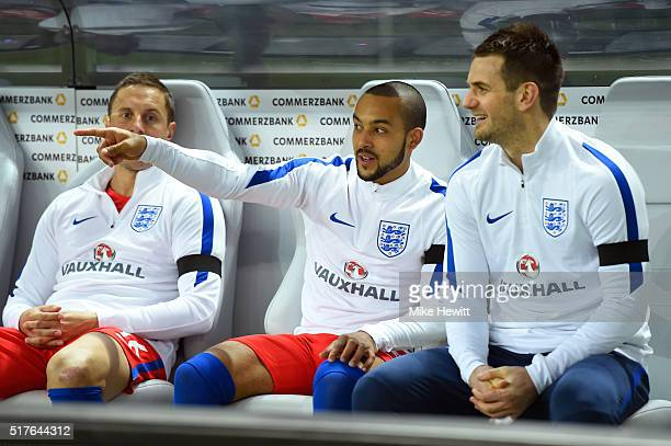 Phil Jagielka Theo Walcott and Tom Heaton of England are seen on the bench during the International Friendly match between Germany and England at...