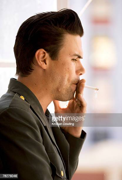 Phil Jamieson of Grinspoon smokes a cigarette during a portrait session on May 31 2007 in Sydney Australia