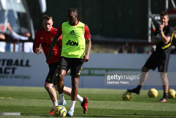 Phil Jones and Aaron Wan-Bissaka of Manchester United in action during first team training session on February 11, 2020 in Malaga, Spain.