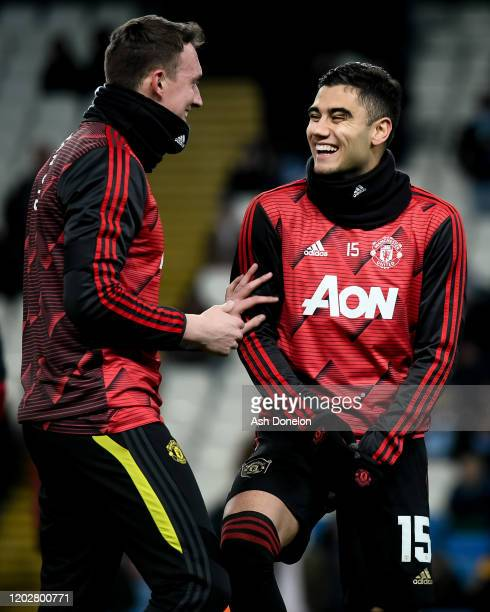 Phil Jones and Andreas Pereira of Manchester United warms up ahead of the Carabao Cup Semi Final match between Manchester City and Manchester United...