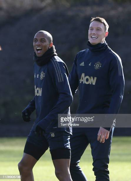 Phil Jones and Anthony Martial of Manchester United in action during a first team training session at Aon Training Complex on February 11 2019 in...