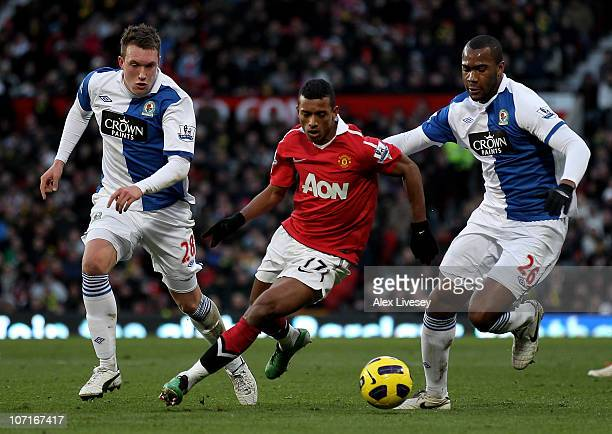 Phil Jones and Herold Goulon of Blackburn Rovers compete with Nani of Manchester United during the Barclays Premier League match between Manchester...