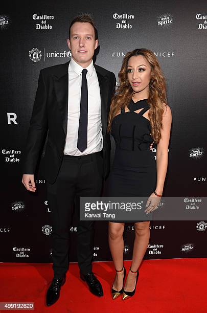 Phil Jones and Kaya Hall attend the United for UNICEF Gala Dinner at Old Trafford on November 29 2015 in Manchester England