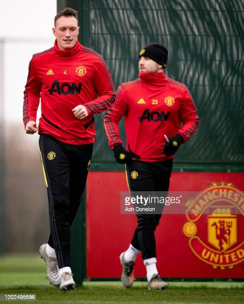 Phil Jones and Luke Shaw of Manchester United in action during a first team training session at Aon Training Complex on January 28, 2020 in...