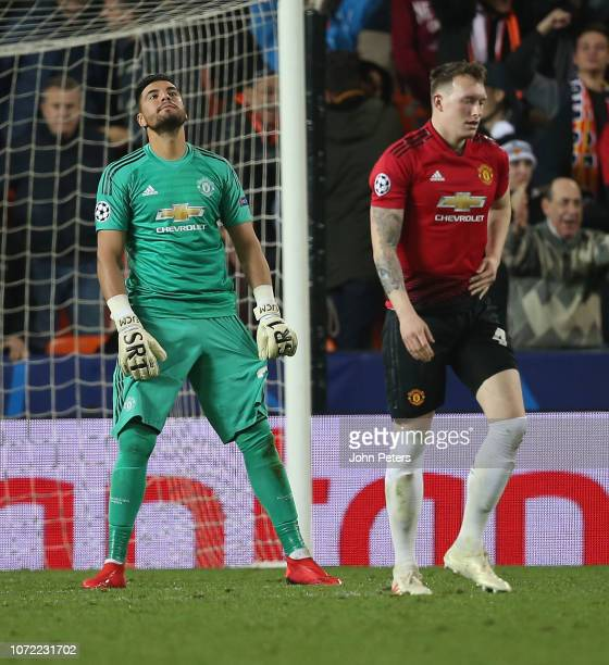 Phil Jones and Sergio Romero of Manchester United react to Phil Jones scoring an own goal during the UEFA Champions League Group H match between...