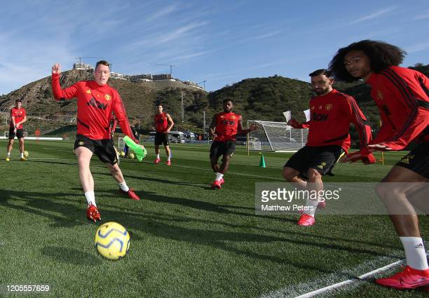 Phil Jones, Bruno Fernandes and Tahith Chong of Manchester United in action during first team training session on February 11, 2020 in Malaga, Spain.