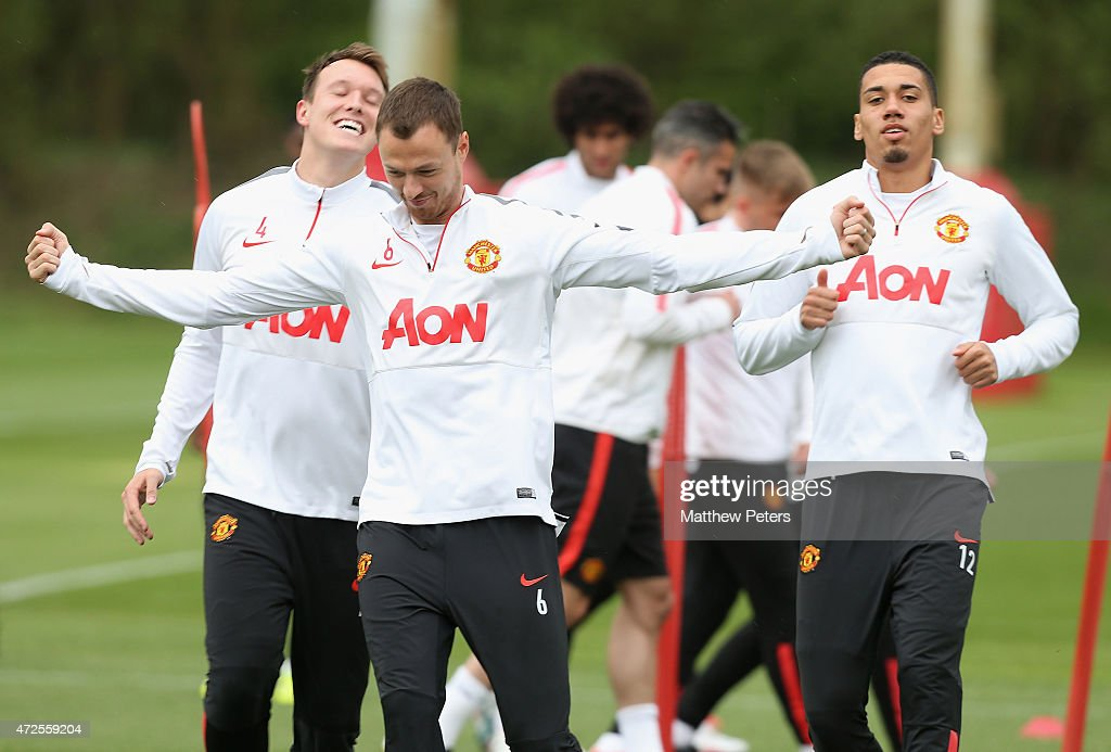 Phil Jones, Jonny Evans and Chris Smalling of Manchester United in action during a first team training session at Aon Training Complex on May 8, 2015 in Manchester, England.