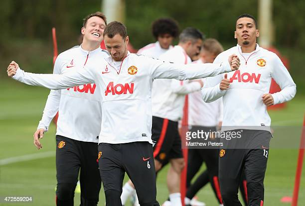 Phil Jones Jonny Evans and Chris Smalling of Manchester United in action during a first team training session at Aon Training Complex on May 8 2015...