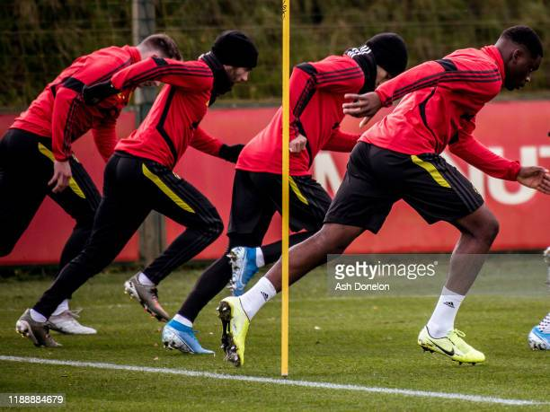 Phil Jones Juan Mata and Teden Mengi of Manchester United in action during a first team training session at Aon Training Complex on November 20 2019...