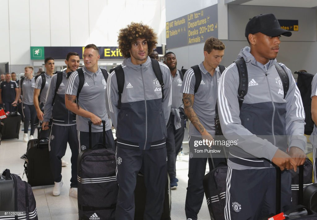 Phil Jones, Marouane Fellaini, Victor Lindelof and Anthony Martial of Manchester United check in at Manchester Airport ahead of the club's pre-season tour of the USA at Manchester Airport on July 9, 2017 in Manchester, England.