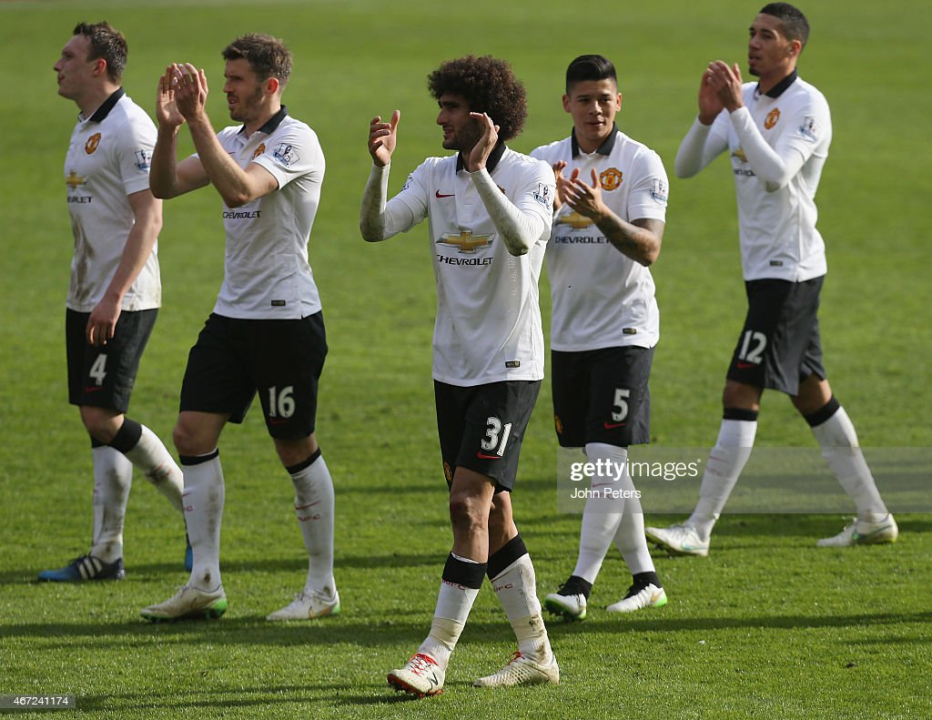 Phil Jones, Michael Carrick, Marouane Fellaini, Marcos Rojo and Chris Smalling of Manchester United celebrate after the Barclays Premier League match between Liverpool and Manchester United at Anfield on March 22, 2015 in Liverpool, England.