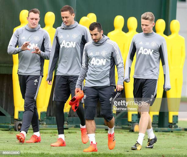Phil Jones Nemanja Matic Henrikh Mkhitaryan and Scott McTominay of Manchester United in action during a first team training session at Aon Training...