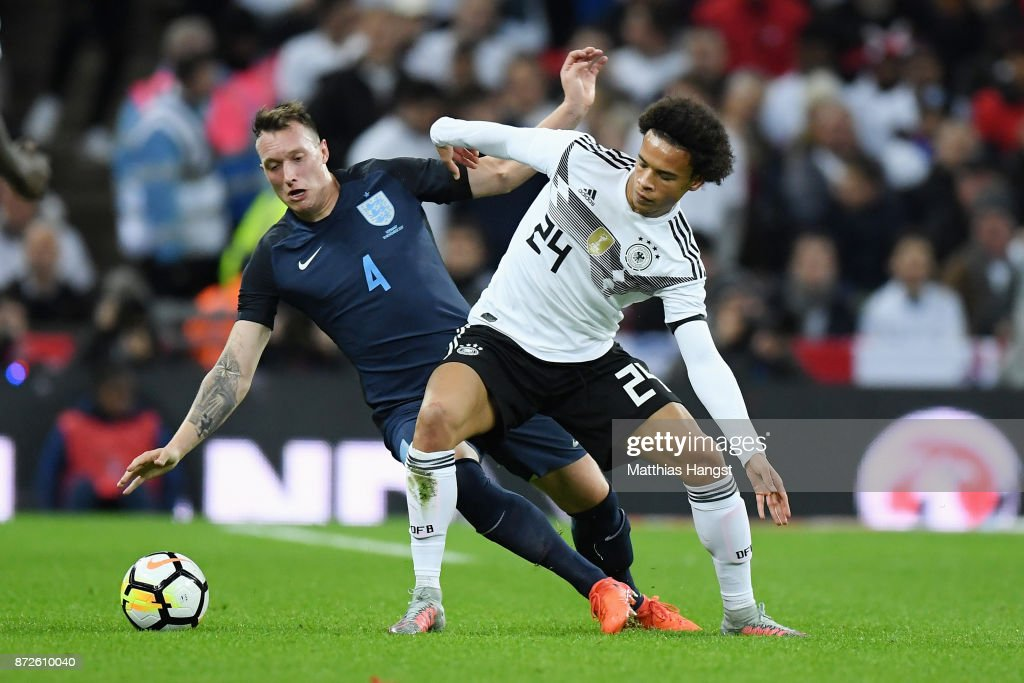 Phil Jones of England and Leroy Sane of Germany battle for possession during the International friendly match between England and Germany at Wembley Stadium on November 10, 2017 in London, England.