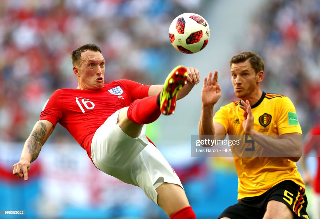 Phil Jones of England clears the ball under pressure from Jan Vertonghen of Belgium during the 2018 FIFA World Cup Russia 3rd Place Playoff match between Belgium and England at Saint Petersburg Stadium on July 14, 2018 in Saint Petersburg, Russia.
