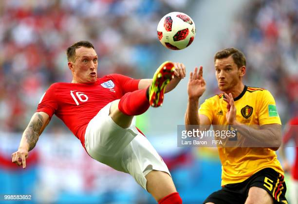 Phil Jones of England clears the ball under pressure from Jan Vertonghen of Belgium during the 2018 FIFA World Cup Russia 3rd Place Playoff match...