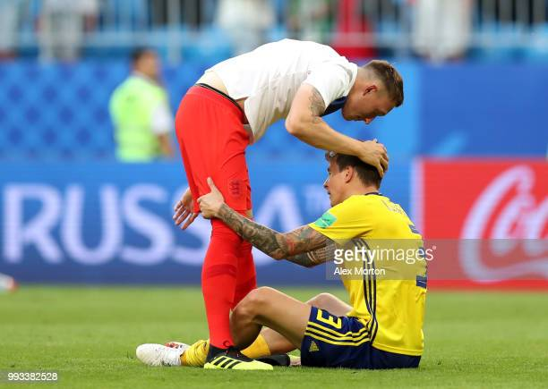 Phil Jones of England consoles Victor Lindelof of Sweden following the 2018 FIFA World Cup Russia Quarter Final match between Sweden and England at...