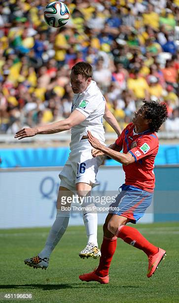 Phil Jones of England heads the ball with Randall Brenes of Costa Rica during the 2014 FIFA World Cup Brazil Group D match between Costa Rica and...
