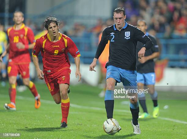 Phil Jones of England in action against Stevan Jovetic of Montenegro during the EURO 2012 group G qualifier match between Montenegro and England at...