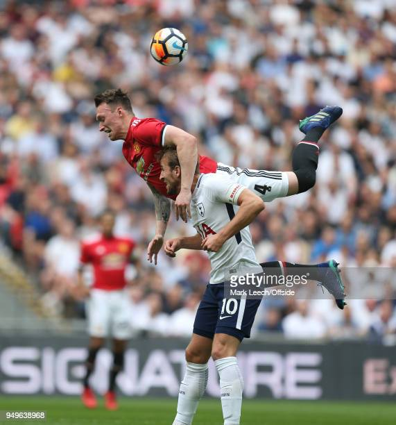Phil Jones of Man Utd jumps above Harry Kane of Tottenham during the FA Cup semi final between Manchester United and Tottenham Hotspur at Wembley...