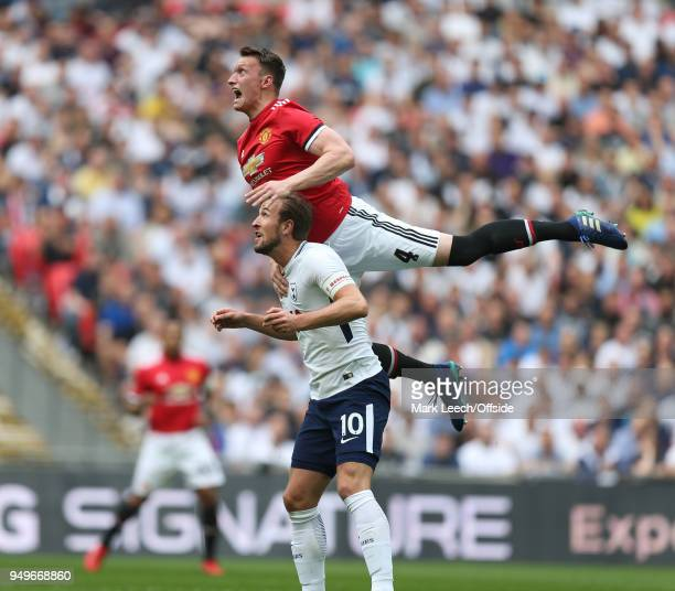 Phil Jones of Man Utd jumps higher than Harry Kane of Tottenham during the FA Cup semi final between Manchester United and Tottenham Hotspur at...