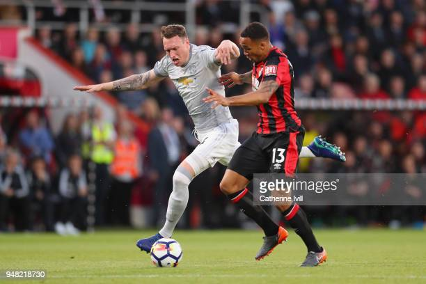 Phil Jones of Manchester United and Callum Wilson of AFC Bournemouth battle for possession during the Premier League match between AFC Bournemouth...