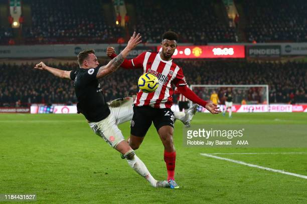Phil Jones of Manchester United and Lys Mousset of Sheffield United during the Premier League match between Sheffield United and Manchester United at...