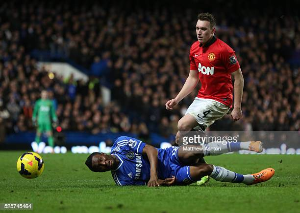 Phil Jones of Manchester United and Mikel John Obi of Chelsea