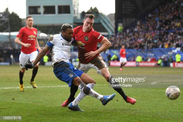 Phil Jones of Manchester United and Morgan Ferrier of Tranmere Rovers during the FA Cup Fourth Round match between Tranmere Rovers and Manchester...