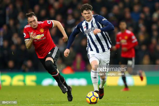 Phil Jones of Manchester United and Oliver Burke of West Bromwich Albion during the Premier League match between West Bromwich Albion and Manchester...