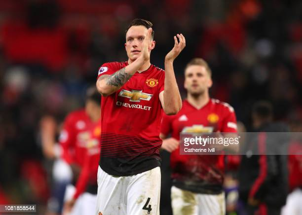 Phil Jones of Manchester United applauds after the Premier League match between Tottenham Hotspur and Manchester United at Wembley Stadium on January...