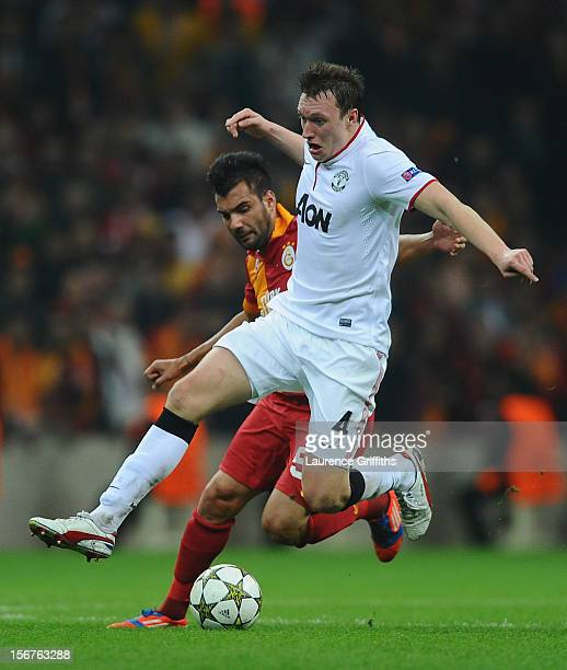 Phil Jones of Manchester United battles with Engin Baytar of Galatasary during the UEFA Champions League Group H match between Galatasaray and...