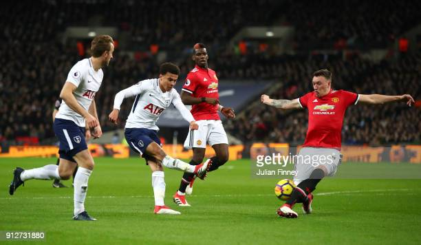 Phil Jones of Manchester United blocks Dele Alli of Tottenham Hotspur shot during the Premier League match between Tottenham Hotspur and Manchester...