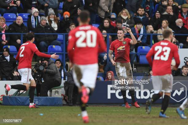 Phil Jones of Manchester United celebrates after scoring his team's fourth goal during the FA Cup Fourth Round match between Tranmere Rovers and...
