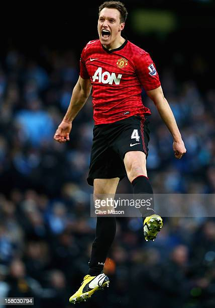 Phil Jones of Manchester United celebrates at the end of the Barclays Premier League match between Manchester City and Manchester United at Etihad...