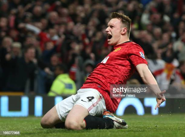Phil Jones of Manchester United celebrates scoring their first goal during the Barclays Premier League match between Manchester United and Manchester...