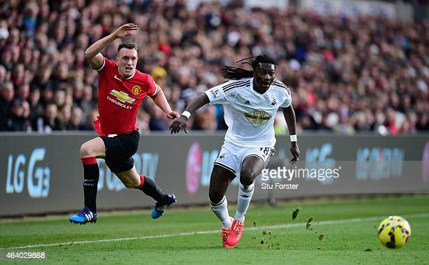 Phil Jones of Manchester United challenges Bafetimbi Gomis of Swansea during the Barclays Premier League match between Swansea City and Manchester...