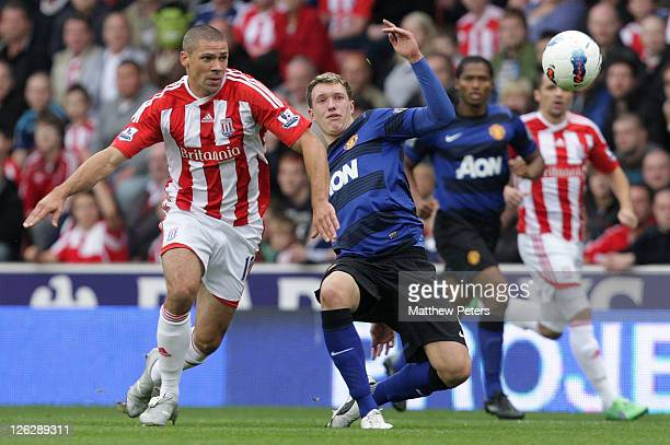 Phil Jones of Manchester United clashes with Jonathan Walters of Stoke City during the Barclays Premier League match between Stoke City and...