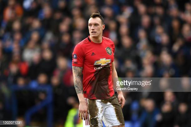 Phil Jones of Manchester United covered in mud during the FA Cup Fourth Round match between Tranmere Rovers and Manchester United at Prenton Park on...