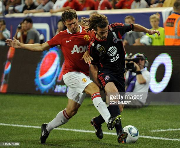 Phil Jones of Manchester United defends against Kyle Beckerman of the MLS allStars in the second half on July 27 2011 at Red Bull Arena in Harrison...