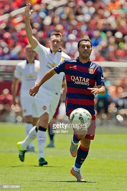 Phil Jones of Manchester United FC signals for an offsides call against Pedro Rodriguez of FC Barcelona during the International Champions Cup on...